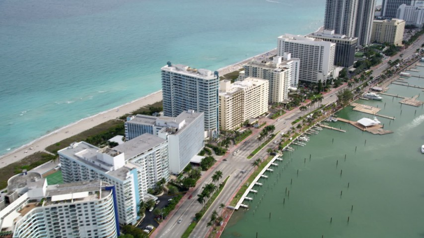 5K stock footage aerial video of oceanfront hotels and condominiums in the coastal city of Miami Beach, Florida Aerial Stock Footage | AX0021_028