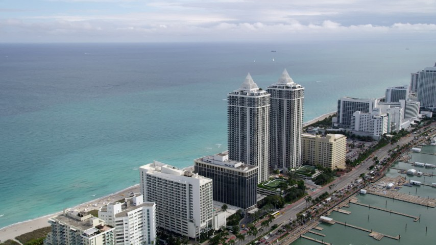 5K aerial video of beachfront hotels by the Blue and Green Diamonds in Miami Beach, Florida Aerial Stock Footage   AX0021_029