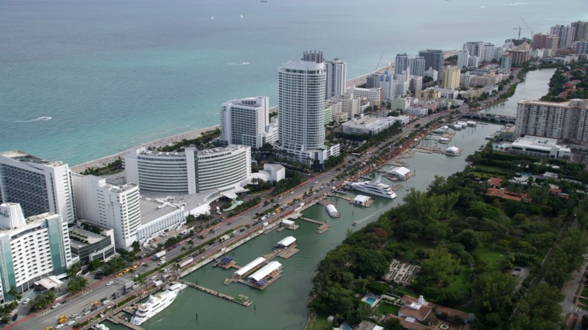 5K aerial video of beachfront resort hotel in Miami Beach, Florida Aerial Stock Footage | AX0021_030