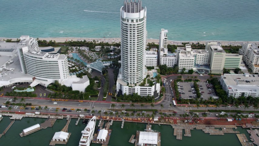 5K stock footage aerial video of beachfront resort hotel with ocean view in Miami Beach, Florida Aerial Stock Footage | AX0021_032