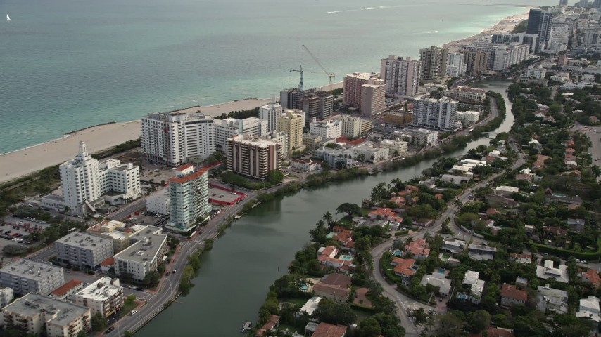 5K stock footage aerial video of beachfront hotels and condominiums in Miami Beach, Florida Aerial Stock Footage | AX0021_033