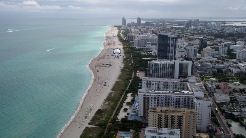 5K aerial video fly over beach to approach hotels and condominiums with ocean views in Miami Beach, Florida Aerial Stock Footage | AX0021_035