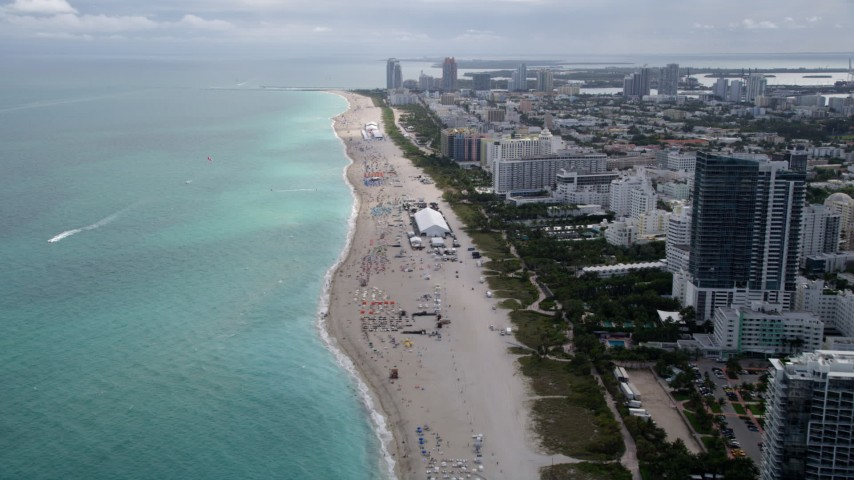 5K stock footage aerial video of following the beach by oceanfront hotels in Miami Beach, Florida Aerial Stock Footage | AX0021_036