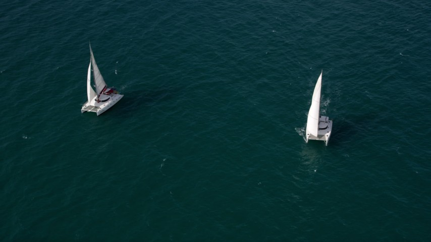 5K stock footage aerial video orbit two catamarans in the clear blue ocean near South Beach, Florida  Aerial Stock Footage | AX0021_039