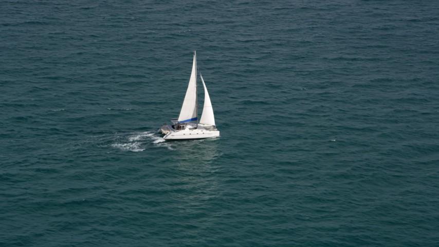 Catamaran Sailing on the Blue Ocean near South Beach, Florida Aerial Stock Footage | AX0021_041