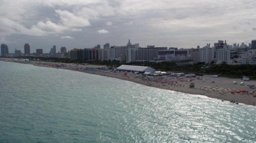 5K stock footage aerial video of beachgoers and oceanfront hotels in Miami Beach, Florida Aerial Stock Footage | AX0021_052