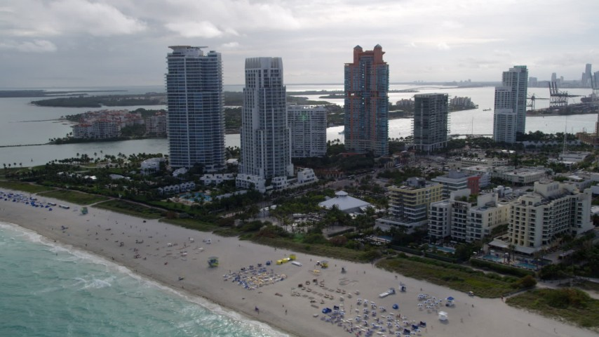 5K stock footage aerial video of modern skyscrapers near the beach in South Beach, Florida Aerial Stock Footage | AX0021_059