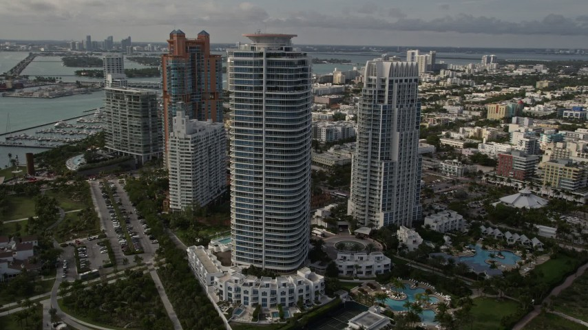 5K stock footage aerial video of modern skyscrapers near the beach in South Beach, Florida Aerial Stock Footage   AX0021_059E
