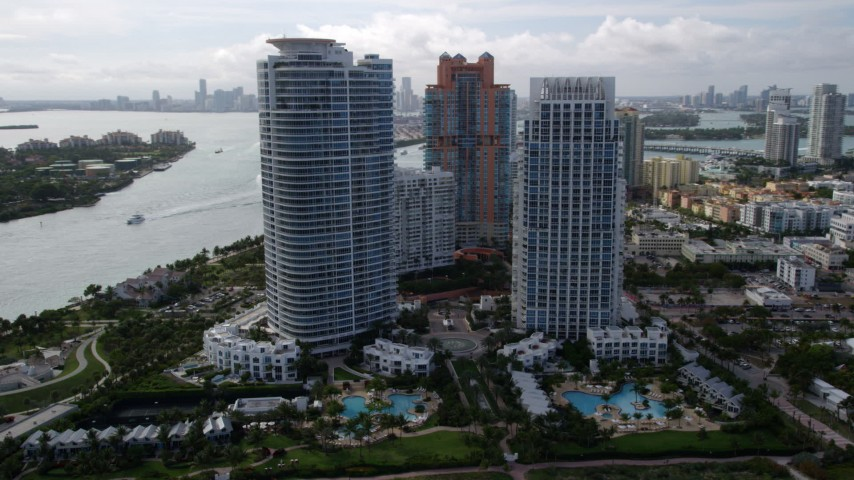 5K stock footage aerial video of two modern skyscrapers near the ocean in South Beach, Florida Aerial Stock Footage | AX0021_060