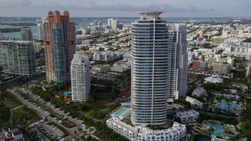 5K stock footage aerial video orbit modern high-rises on the coast in South Beach, Florida Aerial Stock Footage | AX0021_061