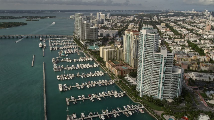 5K stock footage aerial video of waterfront residential skyscrapers and a marina in South Beach, Florida Aerial Stock Footage | AX0021_062