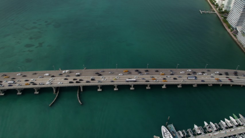 5K stock footage aerial video of slow traffic on the MacArthur Causeway on the shore of South Beach, Florida Aerial Stock Footage | AX0021_063