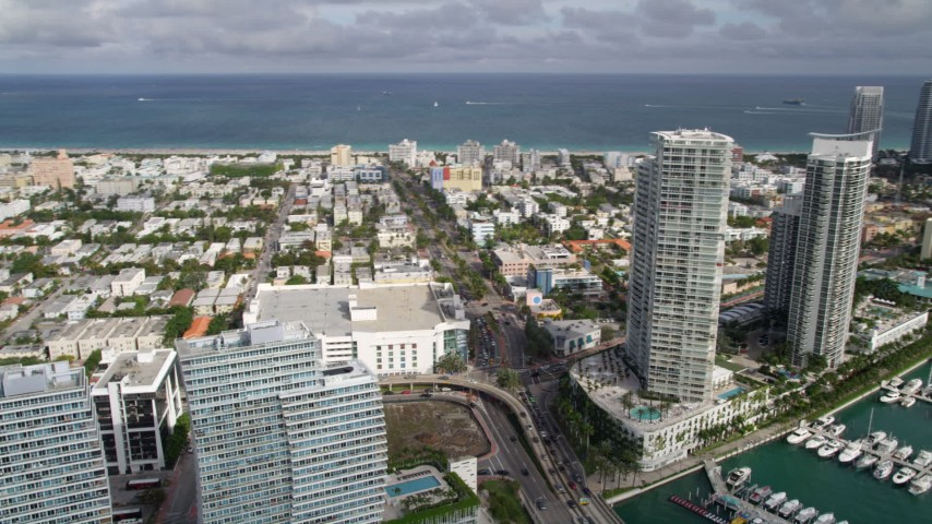 5K stock footage aerial video of residential high-rises by a marina on the shore of South Beach, Florida Aerial Stock Footage | AX0021_064