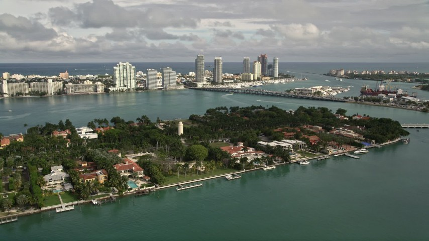 5K stock footage aerial video of spacious bayfront mansions on the shore of Star Island, Florida Aerial Stock Footage | AX0021_068