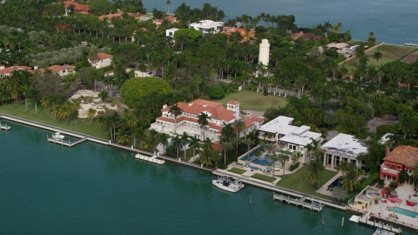 5K stock footage aerial video of a row of mansions on the shore of Star Island, Florida Aerial Stock Footage | AX0021_069