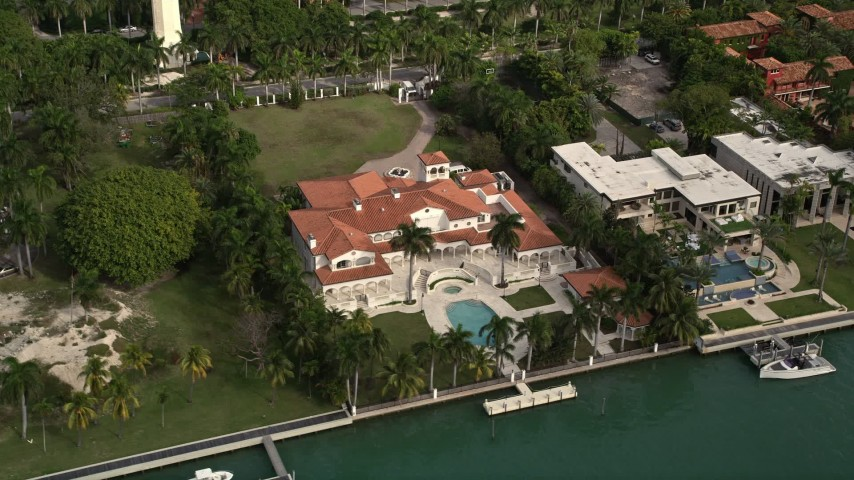 5K stock footage aerial video of a row of mansions on the shore of Star Island, Florida Aerial Stock Footage | AX0021_069E