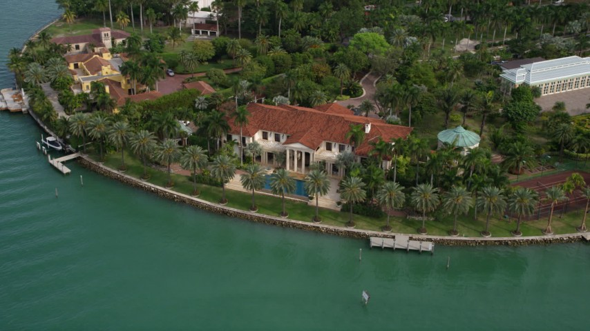 5K stock footage aerial video of a bayfront island estate on Star Island, Florida Aerial Stock Footage | AX0021_072