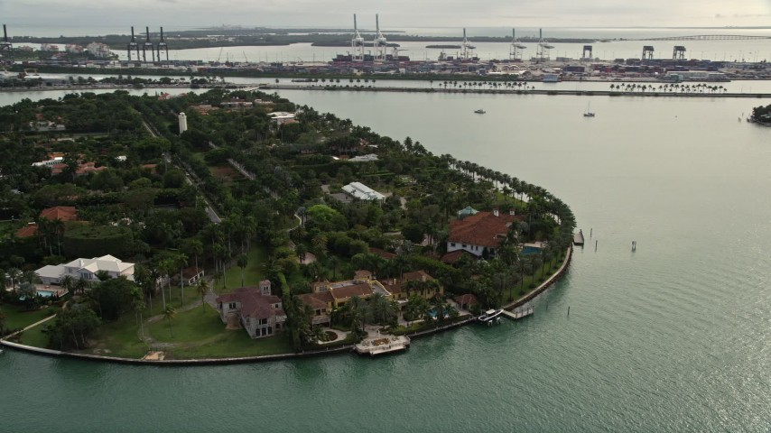 5K stock footage aerial video of waterfront mansions on Star Island, Florida Aerial Stock Footage | AX0021_074