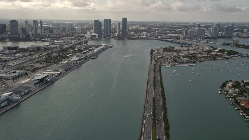 5K aerial video tilt from MacArthur Causeway to reveal Downtown Miami skyscrapers in Florida Aerial Stock Footage | AX0021_076