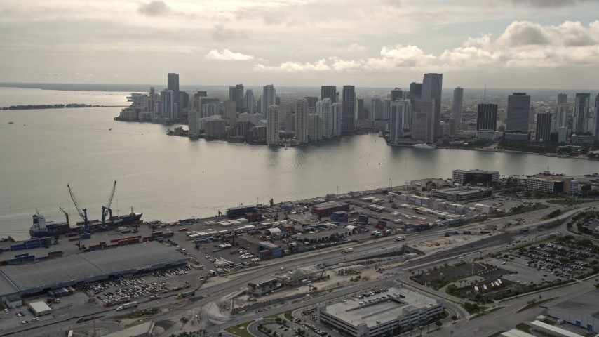 5K stock footage aerial video of Downtown Miami skyline seen from the Port of Miami, Florida Aerial Stock Footage | AX0021_077