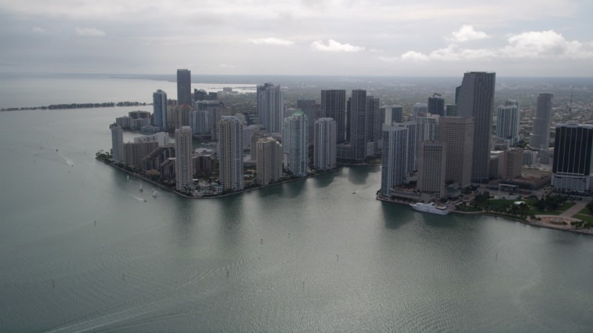 5K stock footage aerial video tilt from Port of Miami to reveal and approach Downtown Miami, Florida Aerial Stock Footage | AX0021_078