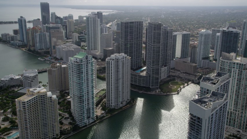 5K stock footage aerial video fly over Miami River to approach high-rise complex in Downtown Miami, Florida Aerial Stock Footage | AX0021_080