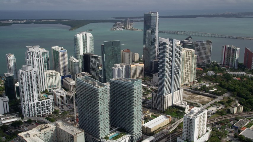 5K stock footage aerial video of Downtown Miami skyscrapers by the shore of the bay in Florida Aerial Stock Footage | AX0021_083