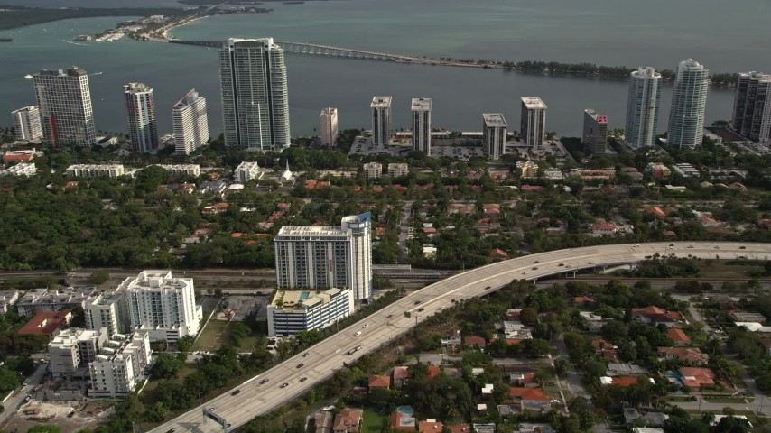 5K stock footage aerial video of Interstate 95 near waterfront condos in Downtown Miami, Florida Aerial Stock Footage | AX0021_084