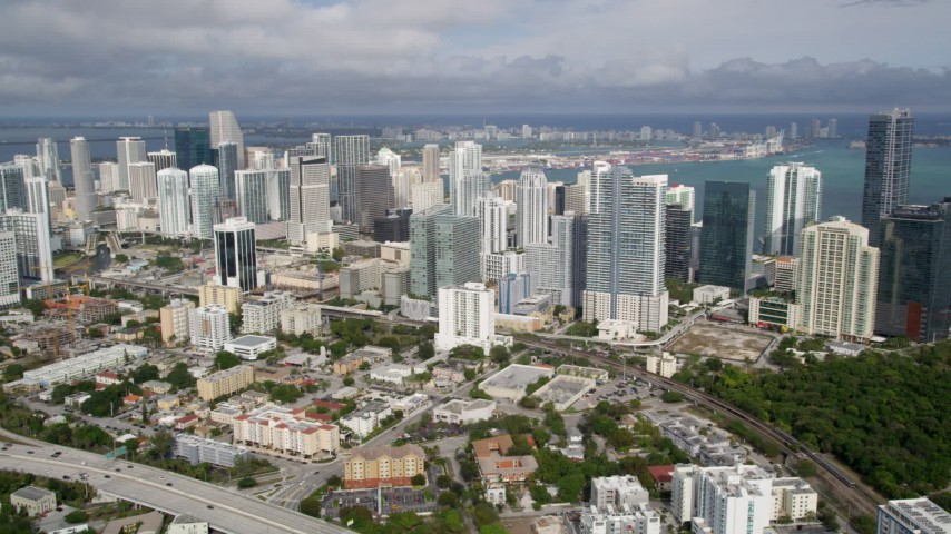 5K stock footage aerial video of skyscrapers in the coastal city of Downtown Miami, Florida Aerial Stock Footage | AX0021_085