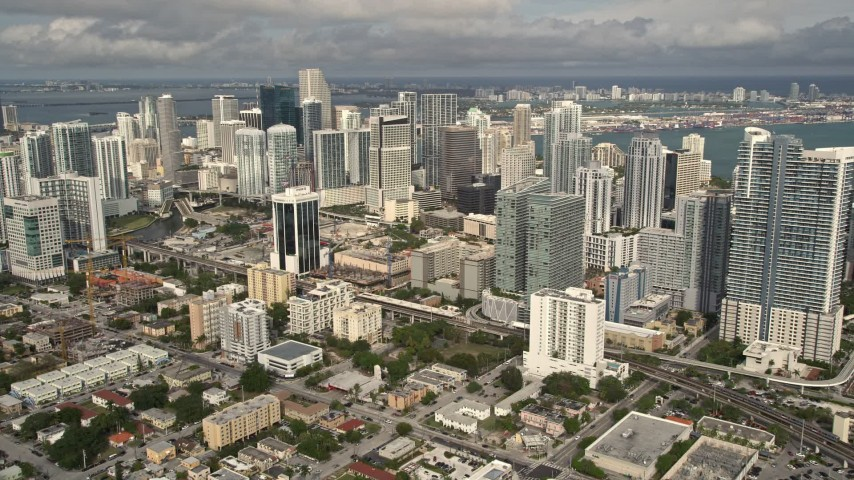 5K stock footage aerial video of skyscrapers in the coastal city of Downtown Miami, Florida Aerial Stock Footage | AX0021_085E