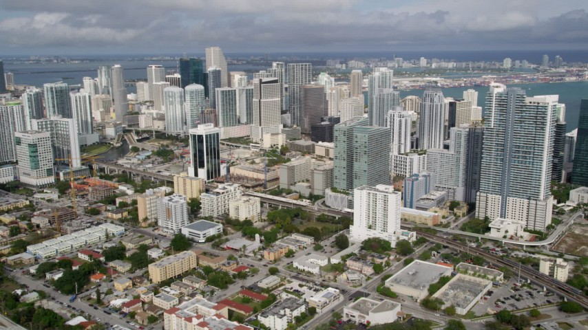 5K stock footage aerial video approach skyscrapers in the coastal city of Downtown Miami, Florida Aerial Stock Footage | AX0021_086