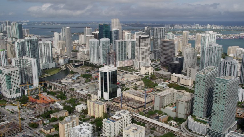 5K stock footage aerial video slow approach to high-rises in the coastal city of Downtown Miami, Florida Aerial Stock Footage | AX0021_087