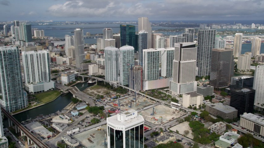 5K stock footage aerial video approach skyscrapers around the Miami River in Downtown Miami, Florida Aerial Stock Footage | AX0021_088