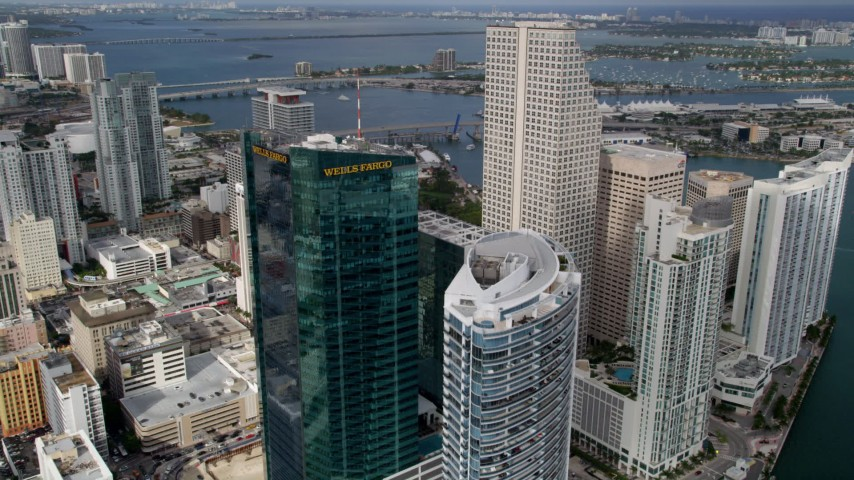5K stock footage aerial video fly over hotel and high-rise tower to approach Southeast Financial Center in Downtown Miami, Florida Aerial Stock Footage | AX0021_091