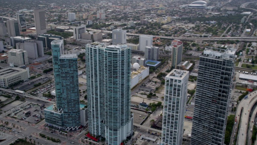 5K stock footage aerial video pan from four skyscrapers to reveal Downtown Miami high-rises, Florida Aerial Stock Footage | AX0021_096