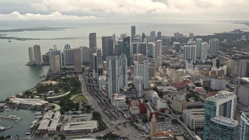 5K stock footage aerial video pan from four skyscrapers to reveal and approach Downtown Miami high-rises, Florida Aerial Stock Footage | AX0021_096E