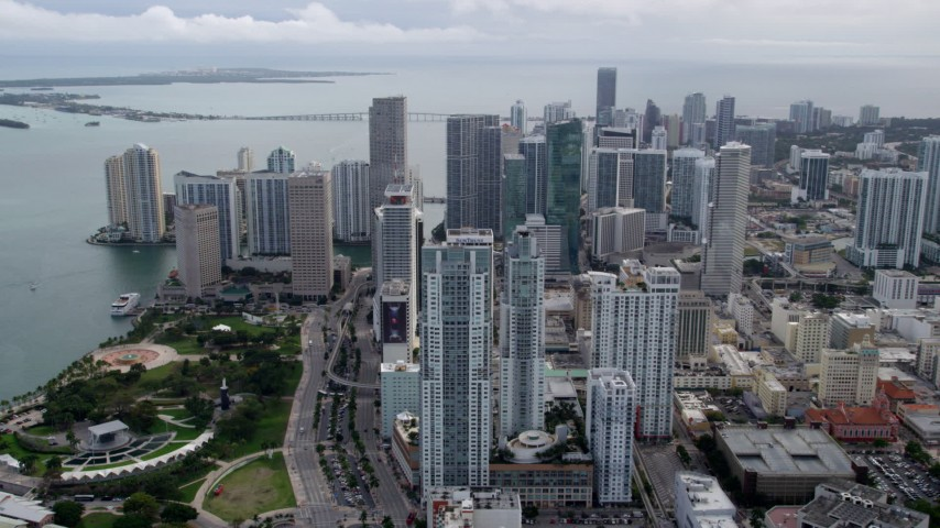 5K stock footage aerial video of slow approach to skyscrapers and Bayfront Park in Downtown Miami, Florida Aerial Stock Footage | AX0021_098