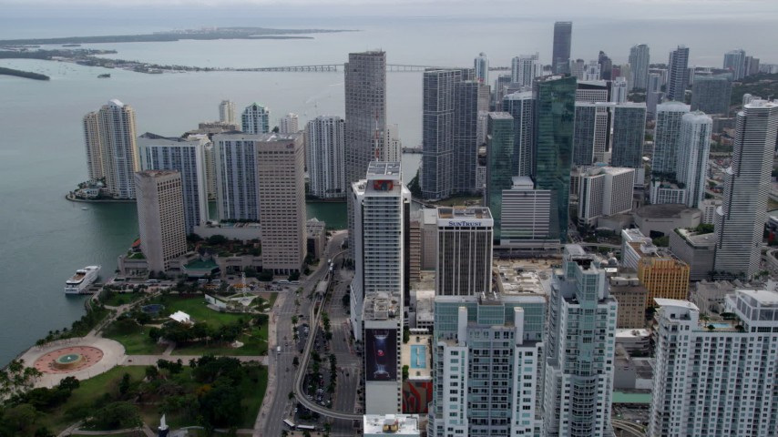 5K stock footage aerial video fly over Bayfront Park to approach Southeast Financial Center in Downtown Miami, Florida Aerial Stock Footage | AX0021_099