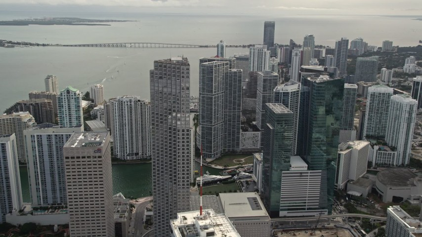 5K stock footage aerial video fly over Bayfront Park to approach Southeast Financial Center in Downtown Miami, Florida Aerial Stock Footage | AX0021_099E