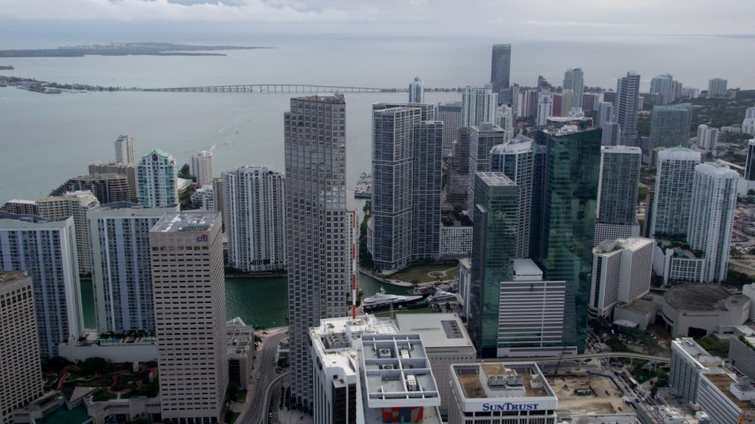 5K aerial video fly over skyscrapers to approach Southeast Financial Center in Downtown Miami, Florida Aerial Stock Footage | AX0021_100