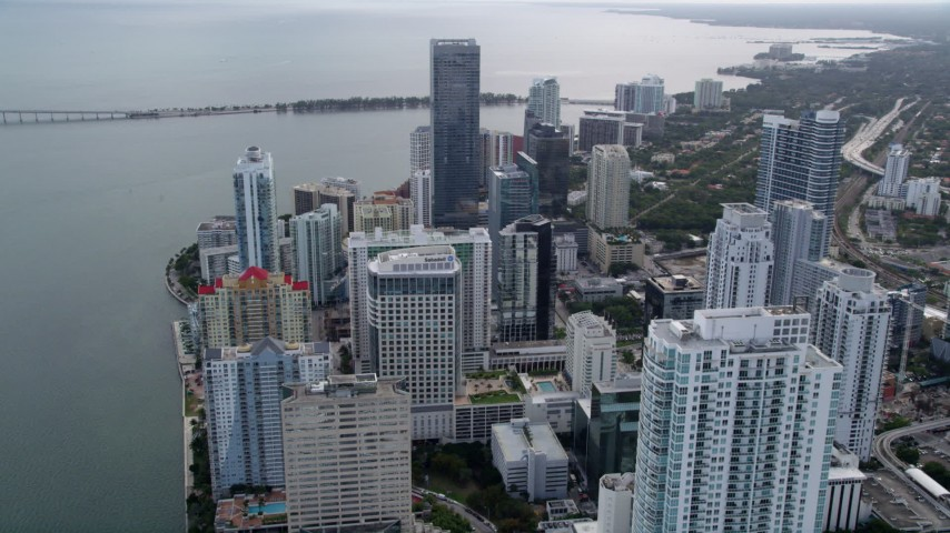 5K stock footage aerial video fly over bayfront skyscrapers to approach Four Seasons Hotel in Downtown Miami, Florida Aerial Stock Footage | AX0021_104