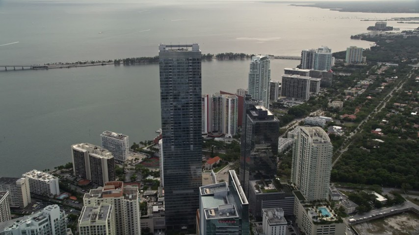 5K stock footage aerial video fly over bayfront skyscrapers to approach Four Seasons Hotel in Downtown Miami, Florida Aerial Stock Footage | AX0021_104E