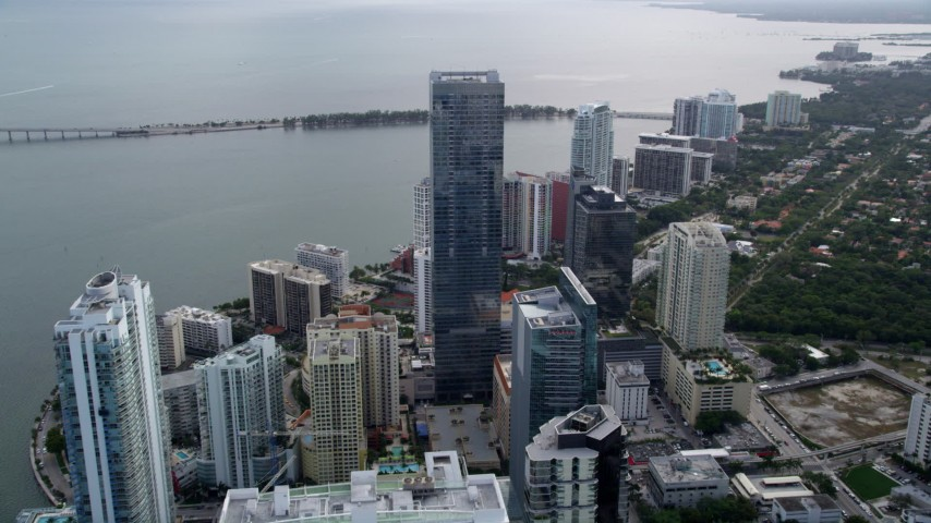5K stock footage aerial video approach the towering Four Seasons Hotel in Downtown Miami, Florida Aerial Stock Footage | AX0021_105