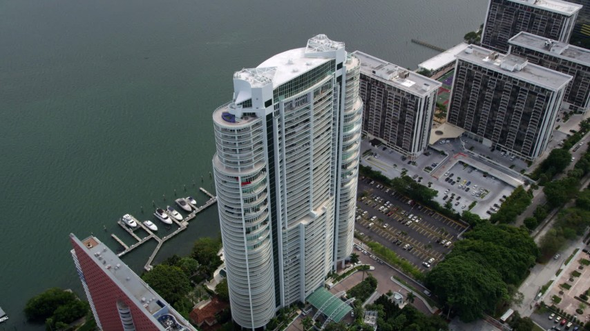5K aerial video approach the Santa Maria waterfront high-rise in Downtown Miami, Florida Aerial Stock Footage | AX0021_107
