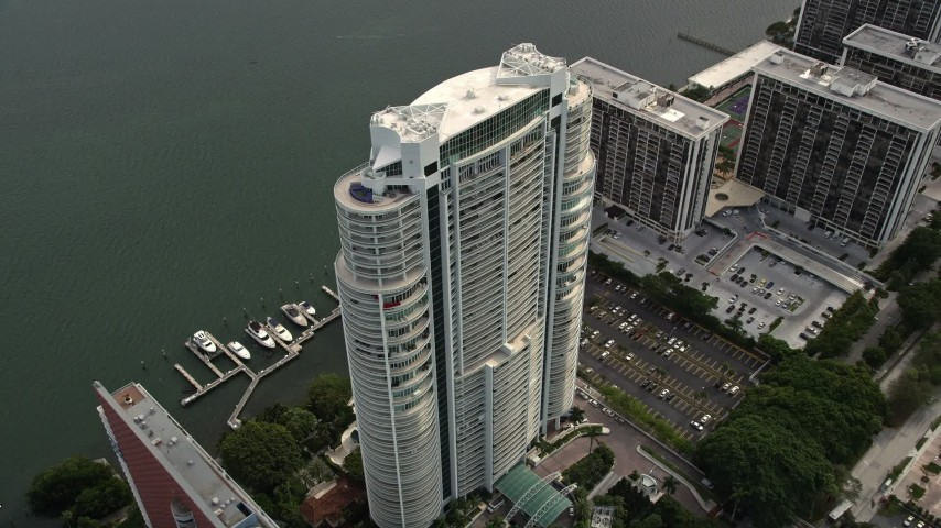 5K stock footage aerial video approach the Santa Maria waterfront high-rise in Downtown Miami, Florida Aerial Stock Footage | AX0021_107E
