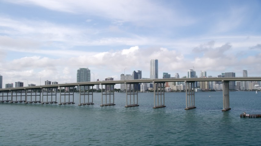 5K stock footage aerial video of Downtown Miami skyline behind the Rickenbacker Causeway, Florida Aerial Stock Footage | AX0021_114