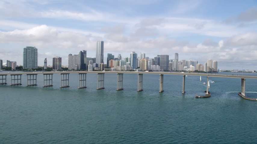 5K stock footage aerial video tilt to reveal and approach Rickenbacker Causeway and Downtown Miami skyline, Florida Aerial Stock Footage | AX0021_115