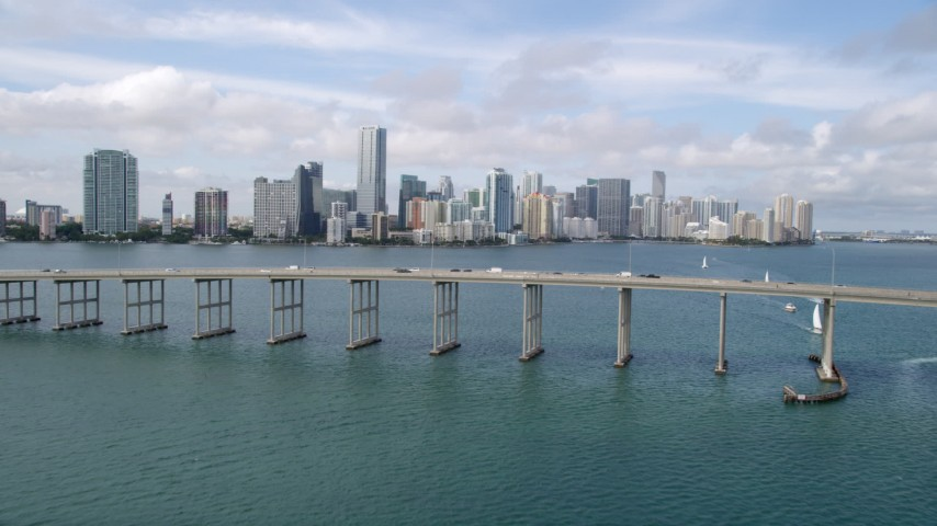 5K aerial video fly over Rickenbacker Causeway to approach coastal city of Downtown Miami, Florida Aerial Stock Footage | AX0021_116