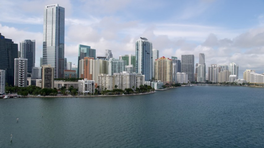 5K stock footage aerial video tilt to reveal skyline of Downtown Miami, Florida Aerial Stock Footage | AX0021_117