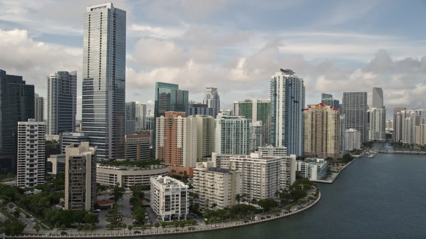 5K stock footage aerial video tilt to reveal skyline of Downtown Miami, Florida Aerial Stock Footage   AX0021_117E